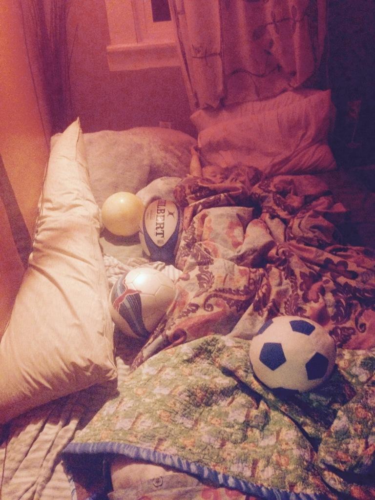 Amongst those balls is a little boy...